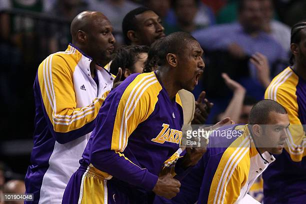 Lamar Odom, Ron Artest and Jordan Farmar of the Los Angeles Lakers support their teammates from the bench against the Boston Celtics in Game Three of...