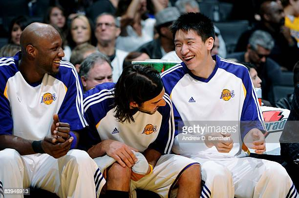 Lamar Odom Sasha Vujacic and Sun Yue of the Los Angeles Lakers share a laugh from the bench during their game against the Milwaukee Bucks at Staples...
