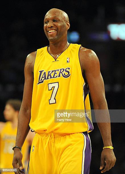 Lamar Odum of the Los Angeles Lakers laughs after a timeout call against the New Orleans Hornets during the second half at Staples Center on December...