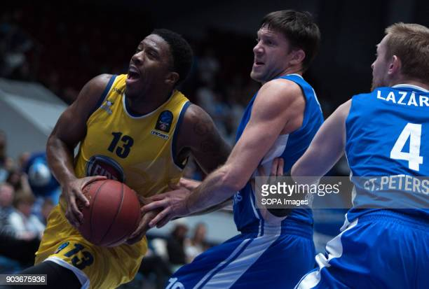 Lamar Patterson of Fiat Turin and Evgeny Voronov Ivan Lazarev of Zenit St Petersburg vie for the ball during the EuroCup Round 2 Top 16 basketball...