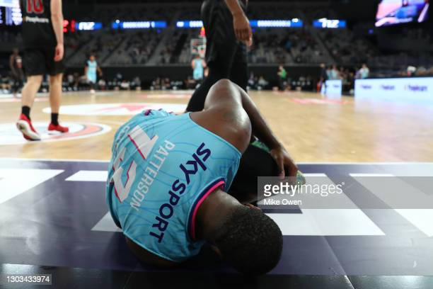 Lamar Patterson of the Breakers is seen clutching his left knee after falling down during the NBL Cup match between the Illawarra Hawks and New...