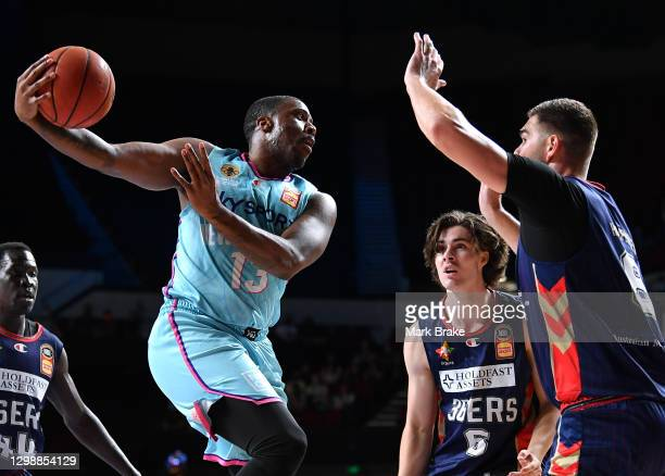 Lamar Patterson of the Breakers passes over Issac Humphries of the 36ers during the round three NBL match between the Adelaide 36ers and the New...