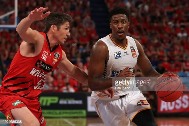 Lamar Patterson of the Bullets brings the ball up the court against Damian Martin of the Wildcats during the round 19 NBL match between the Perth...