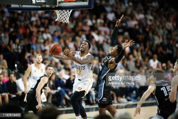 Lamar Patterson of the Bullets goes up against Scotty Hopson of the Breakers during the round 10 NBL match between the New Zealand Breakers and the...