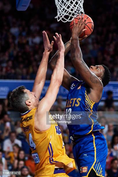 Lamar Patterson of the Bullets lays up a shot during the round 12 NBL match between the Brisbane Bullets and the Sydney Kings at Nissan Arena on...