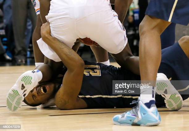 Lamar Patterson of the Pittsburgh Panthers with the ball against Dorian FinneySmith of the Florida Gators in the first half during the third round of...