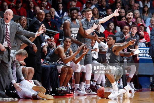 Lamar Peters of the Mississippi State Bulldogs pleads for the call after a loose ball scramble against the Dayton Flyers in the second half of the...