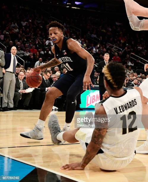 Lamar Stevens of the Penn State Nittany Lions is defended by Vincent Edwards of the Purdue Boilermakers during the semifinals of the Big Ten...