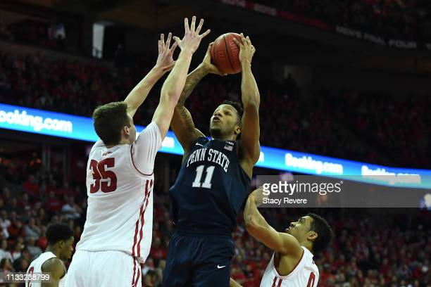 Lamar Stevens of the Penn State Nittany Lions shoots over Nate Reuvers of the Wisconsin Badgers during the first half of a game at Kohl Center on...
