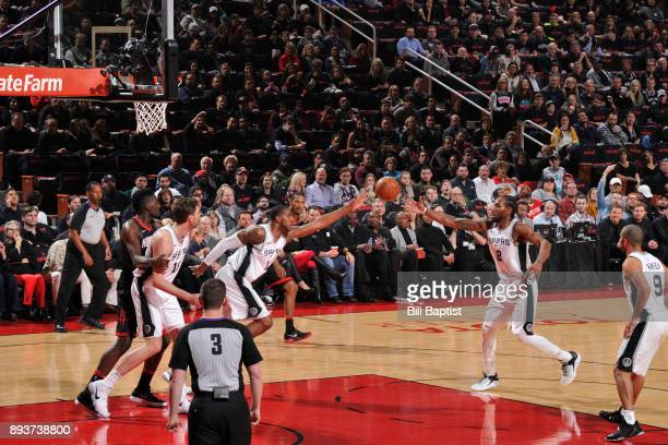 LaMarcus Aldridge and Kawhi Leonard of the San Antonio Spurs pass the ball against the Houston Rockets on December 15 2017 at the Toyota Center in...