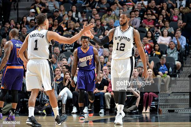 LaMarcus Aldridge and Kyle Anderson of the San Antonio Spurs high five each other during the game against the Phoenix Suns on December 28 2016 at the...