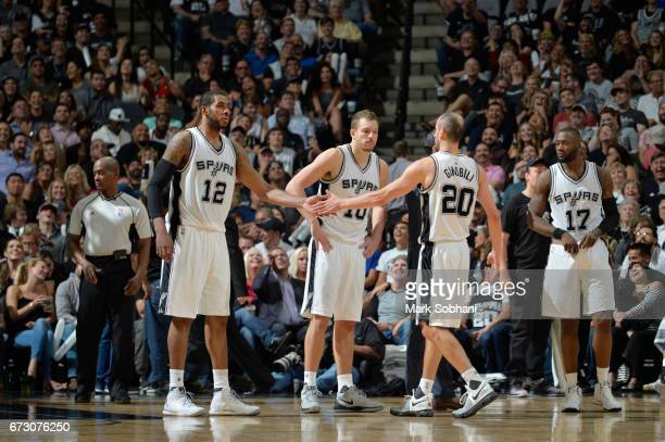 LaMarcus Aldridge and Manu Ginobili of the San Antonio Spurs celebrate during Game Five of the Western Conference Quarterfinals of the 2017 NBA...