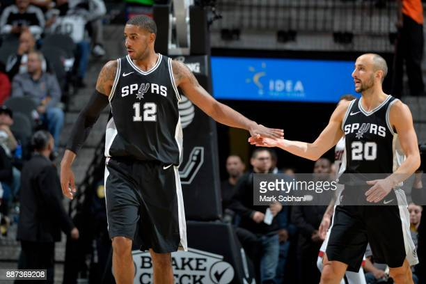 LaMarcus Aldridge and Manu Ginobili of the San Antonio Spurs high five during the game against the Miami Heat on December 6 2017 at the ATT Center in...