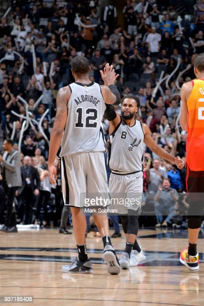 LaMarcus Aldridge and Patty Mills of the San Antonio Spurs react to a play during the game against the Utah Jazz on March 23 2018 at the ATT Center...