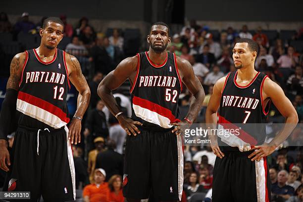 LaMarcus Aldridge Greg Oden and Brandon Roy of the Portland Trail Blazers stand on the court during the game against the Charlotte Bobcats at Time...