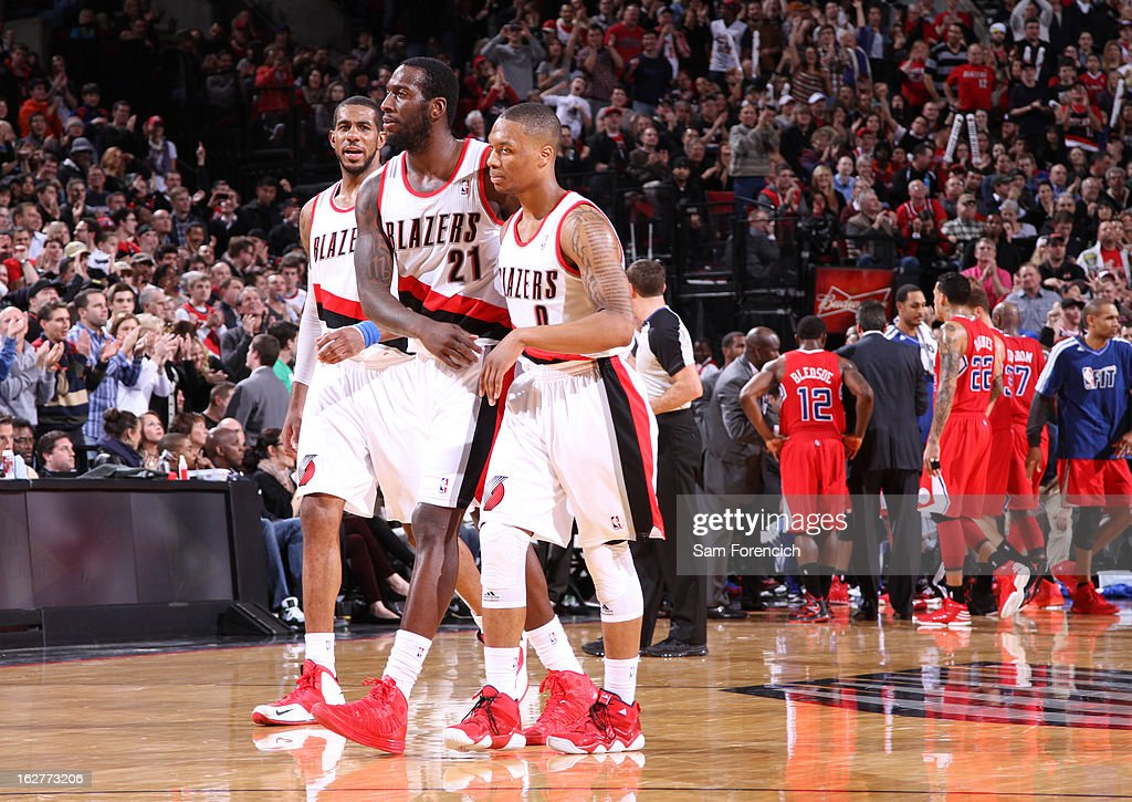 LaMarcus Aldridge #12, J.J. Hickson #21 and Damian Lillard #0 of the Portland Trail Blazers walk off the court during the game against the Los Angeles Clippers on January 26, 2013 at the Rose Garden Arena in Portland, Oregon.
