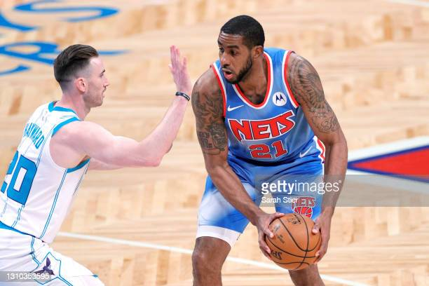LaMarcus Aldridge of the Brooklyn Nets dribbles against Gordon Hayward of the Charlotte Hornets during the first half at Barclays Center on April 01,...