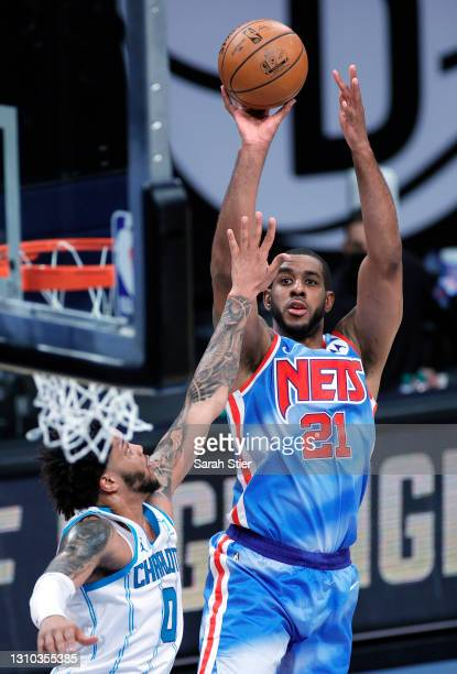 LaMarcus Aldridge of the Brooklyn Nets shoots as Miles Bridges of the Charlotte Hornets defends during the first half at Barclays Center on April 01,...