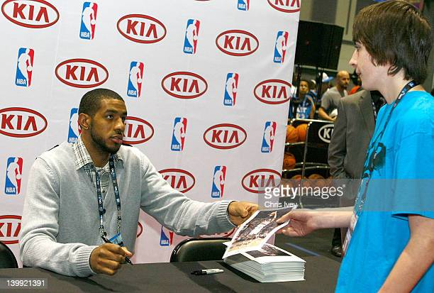 LaMarcus Aldridge of the Porland Trailblazers sign autographs for fans in the Kia MVP Court at Jam Session during NBA All Star Weekend on February...