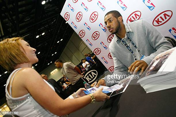 LaMarcus Aldridge of the Porland Trailblazers sign autographs for fans in the Kia MVP Court at Jam Session during NBA All Star Weekend on February 24...