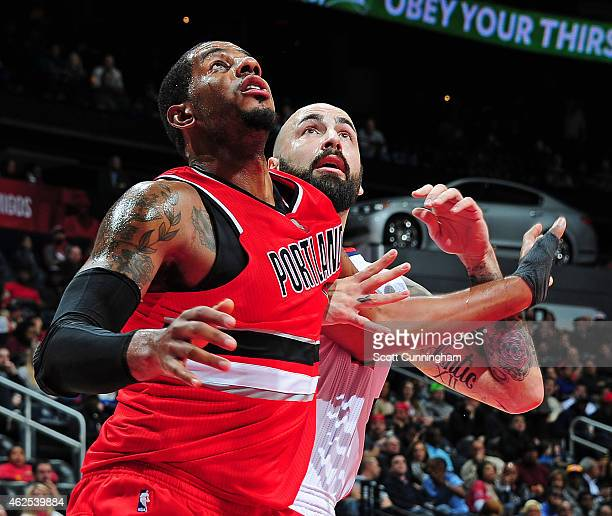 LaMarcus Aldridge of the Portland Trail Blazers boxes out against Pero Antic of the Atlanta Hawks on January 30 2015 at Philips Arena in Atlanta...