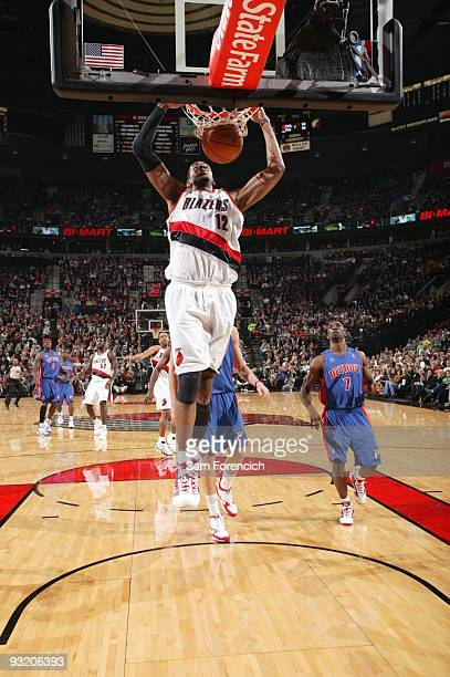 LaMarcus Aldridge of the Portland Trail Blazers dunks past Ben Gordon of the Detroit Pistons during a game on November 18 2009 at the Rose Garden...
