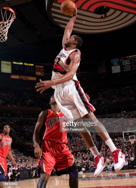 LaMarcus Aldridge of the Portland Trail Blazers goes up for a dunk over Al Harrington of the Golden State Warriors during a game on January 9 2008 at...