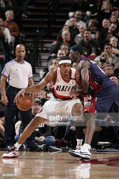 LaMarcus Aldridge of the Portland Trail Blazers looks for an opening around Ben Wallace of the Cleveland Cavaliers during a game at the Rose Garden...