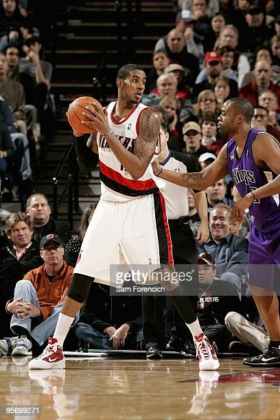 LaMarcus Aldridge of the Portland Trail Blazers looks to pass over Kenny Thomas of the Sacramento Kings during the game on December 15 2009 at the...