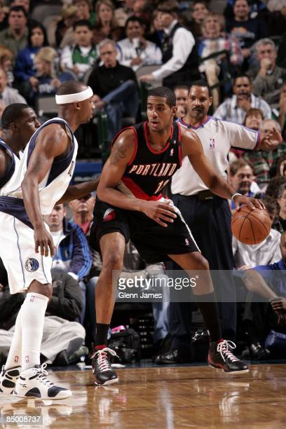 LaMarcus Aldridge of the Portland Trail Blazers moves the ball against Jason Terry of the Dallas Mavericks during the game at American Airlines...
