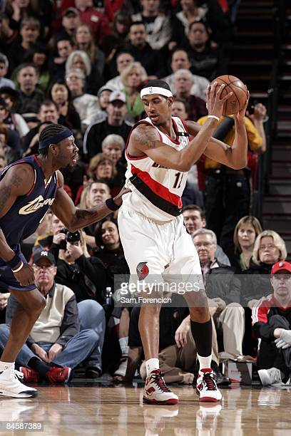 LaMarcus Aldridge of the Portland Trail Blazers posts up against Ben Wallace of the Cleveland Cavaliers at The Rose Garden on January 21 2009 in...