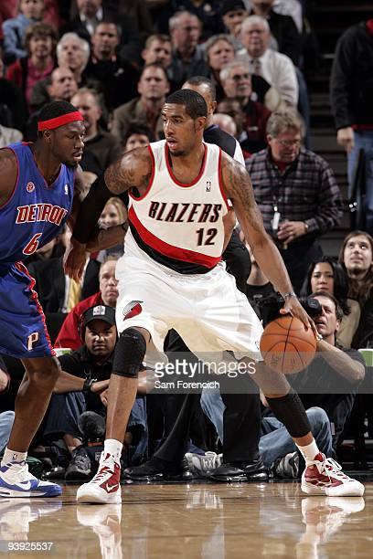 LaMarcus Aldridge of the Portland Trail Blazers posts up against Ben Wallace of the Detroit Pistons during the game at The Rose Garden on November 18...