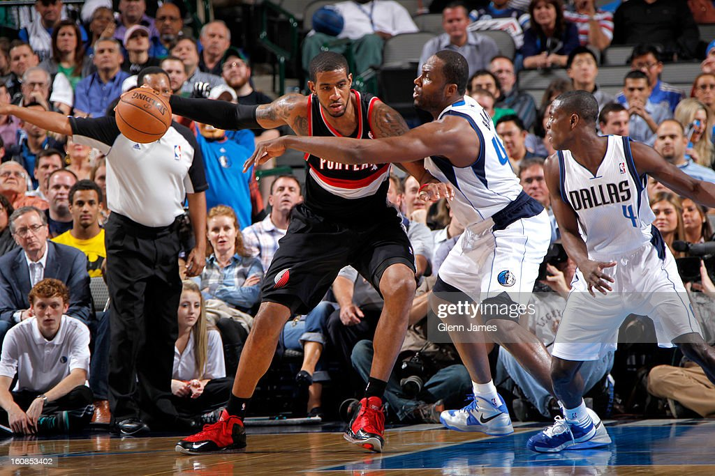 LaMarcus Aldridge #12 of the Portland Trail Blazers posts up against Elton Brand #42 of the Dallas Mavericks on February 6, 2013 at the American Airlines Center in Dallas, Texas.