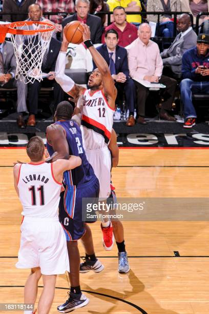 LaMarcus Aldridge of the Portland Trail Blazers rises for a dunk against DeSagana Diop of the Charlotte Bobcats on March 4 2013 at the Rose Garden...