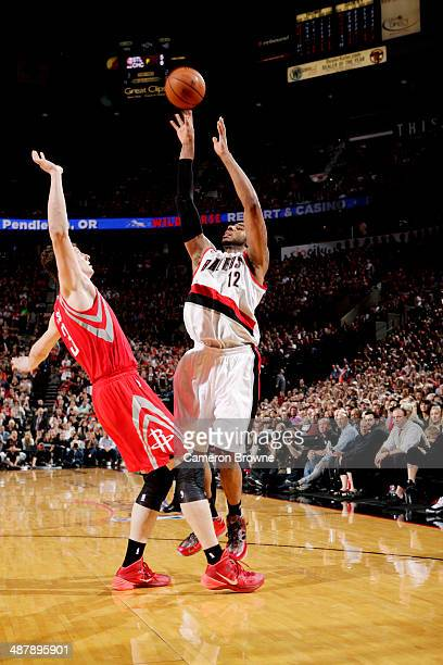 LaMarcus Aldridge of the Portland Trail Blazers shoots against Omer Asik of the Houston Rockets in Game Six of the Western Conference Quarterfinals...