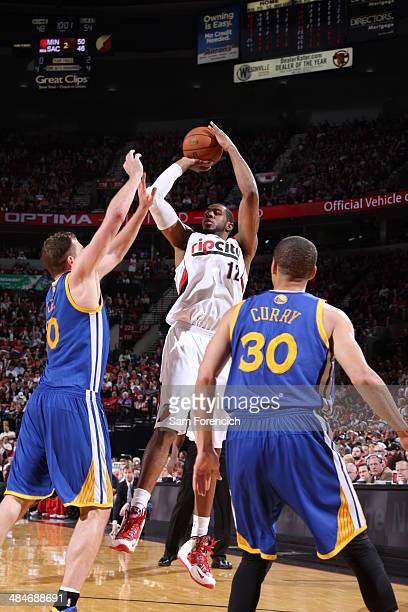 LaMarcus Aldridge of the Portland Trail Blazers shoots against the Golden State Warriors on April 13 2014 at the Moda Center Arena in Portland Oregon...