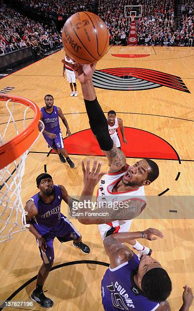LaMarcus Aldridge of the Portland Trail Blazers takes a jump shot over DeMarcus Cousins of the Sacramento Kings during the game on January 23 2012 at...