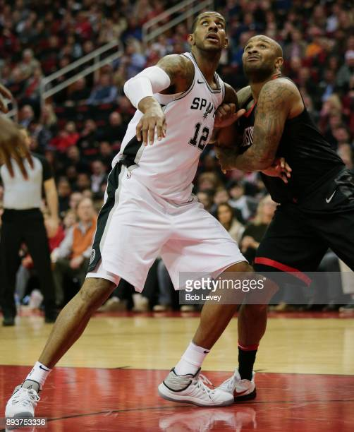 LaMarcus Aldridge of the San Antonio Spurs and PJ Tucker of the Houston Rockets position for a rebound at Toyota Center on December 15 2017 in...