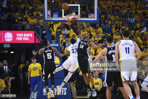 LaMarcus Aldridge of the San Antonio Spurs blocks the shot of Draymond Green of the Golden State Warriors in the first quarter during Game One of the...
