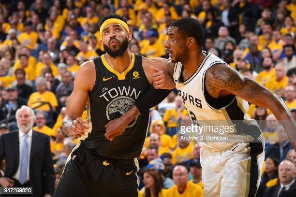 LaMarcus Aldridge of the San Antonio Spurs boxes out against JaVale McGee of the Golden State Warriors in Game Two of Round One of the 2018 NBA...