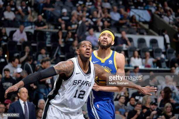 LaMarcus Aldridge of the San Antonio Spurs boxes out JaVale McGee of the Golden State Warriors during Game Three of the Western Conference...