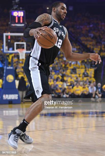 LaMarcus Aldridge of the San Antonio Spurs dribbles the ball against the Golden State Warriors in the first quarter during Game One of the first...