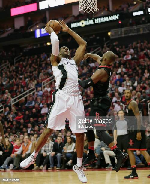 LaMarcus Aldridge of the San Antonio Spurs drives to basket on Chris Paul of the Houston Rockets at Toyota Center on December 15 2017 in Houston...