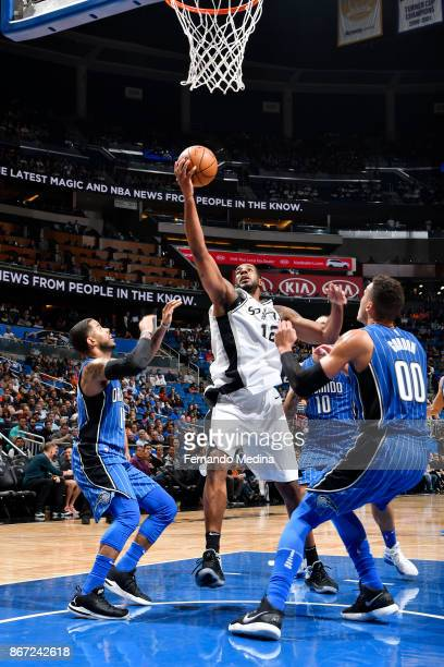 LaMarcus Aldridge of the San Antonio Spurs drives to the basket against the Orlando Magic on October 27 2017 at Amway Center in Orlando Florida NOTE...