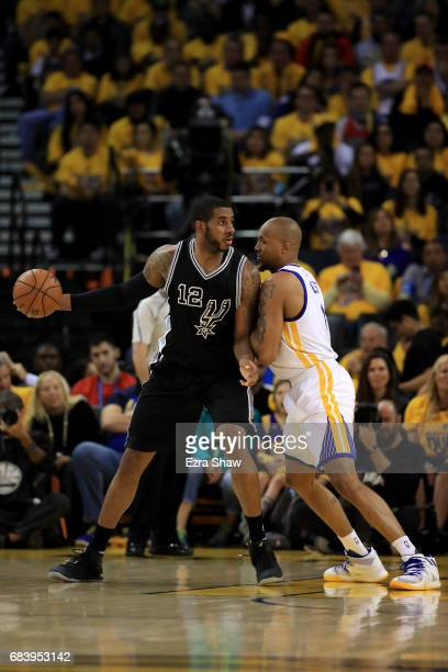 LaMarcus Aldridge of the San Antonio Spurs drives with the ball against David West of the Golden State Warriors during Game Two of the NBA Western...