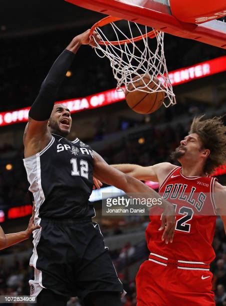 LaMarcus Aldridge of the San Antonio Spurs dunks over Robin Lopez of the Chicago Bulls at the United Center on November 26 2018 in Chicago Illinois...