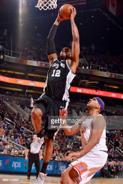 LaMarcus Aldridge of the San Antonio Spurs dunks the ball against the Phoenix Suns on December 9 2017 at Talking Stick Resort Arena in Phoenix...