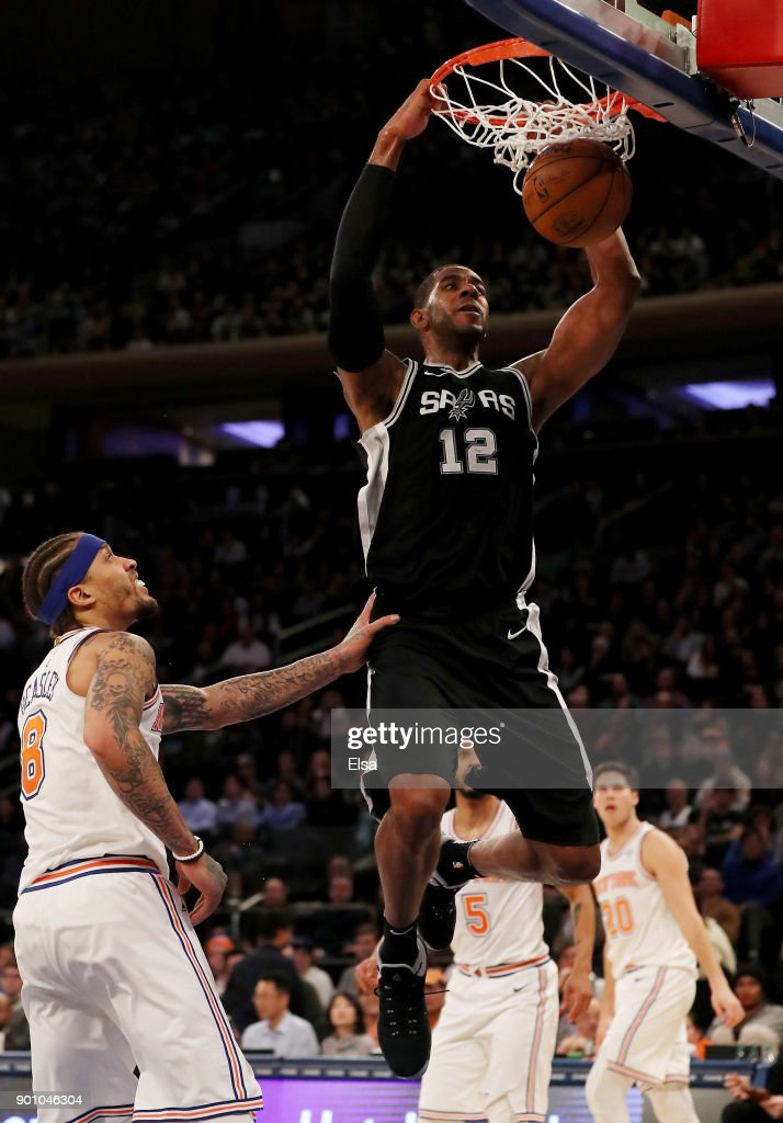 LaMarcus Aldridge #12 of the San Antonio Spurs dunks the ball as Michael Beasley #8 of the New York Knicks defends in the second half at Madison Square Garden on January 02, 2018 in New York City.