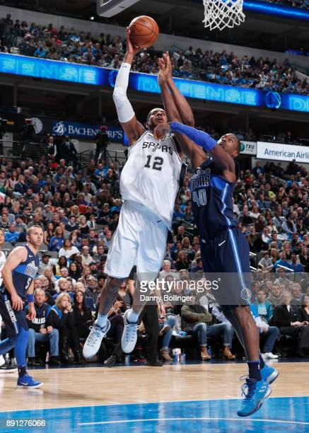 LaMarcus Aldridge of the San Antonio Spurs goes to the basket against Harrison Barnes of the Dallas Mavericks on December 12 2017 at the American...