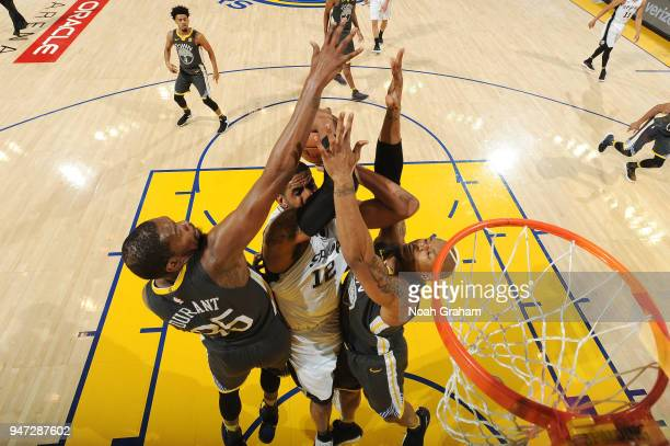 LaMarcus Aldridge of the San Antonio Spurs goes to the basket against the Golden State Warriors in Game Two of Round One of the 2018 NBA Playoffs on...